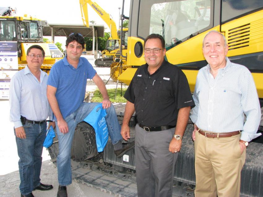 Discussing the Komatsu machines on display at Linder's Pembroke Pines event (L-R) are Miguel Escoto and Fred Sanchez of Teran Industries, Miami; Jon Novaro, Linder; and Edmundo Mendieta, H-E Parts International, Miami.