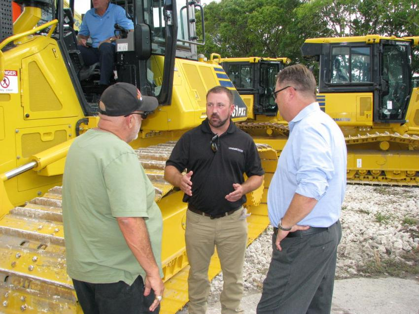 (L-R): Sam Lobue, Downrite Engineering, Miami; Chris Brazel, Linder technology solutions expert; and Jeff Roberts, Linder regional vice-president talk about the four Komatsu D61PXi intelligent Machine Control dozer Lobue plans to purchase at the Pembroke Pines Open House.