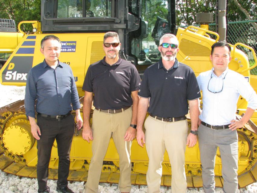 Strong support at the Pembroke Pines open house came from representatives of Komatsu America and Komatsu Japan (L-R) including Naoyuki Sakurai, Willie Ramos, Bill Jacobi and Taz Fujimoto.