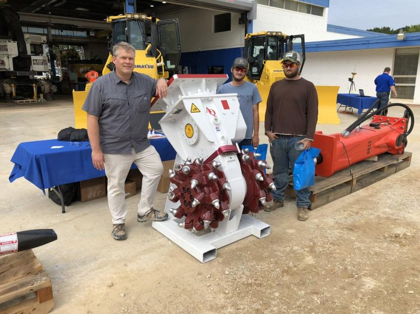 (L-R):  James Bulebush of Antraquip goes over the AQ4 rock-grinding tool with Alec and Evan Vaughn of G. Goodwin Enterprises in Clayton, N.C.