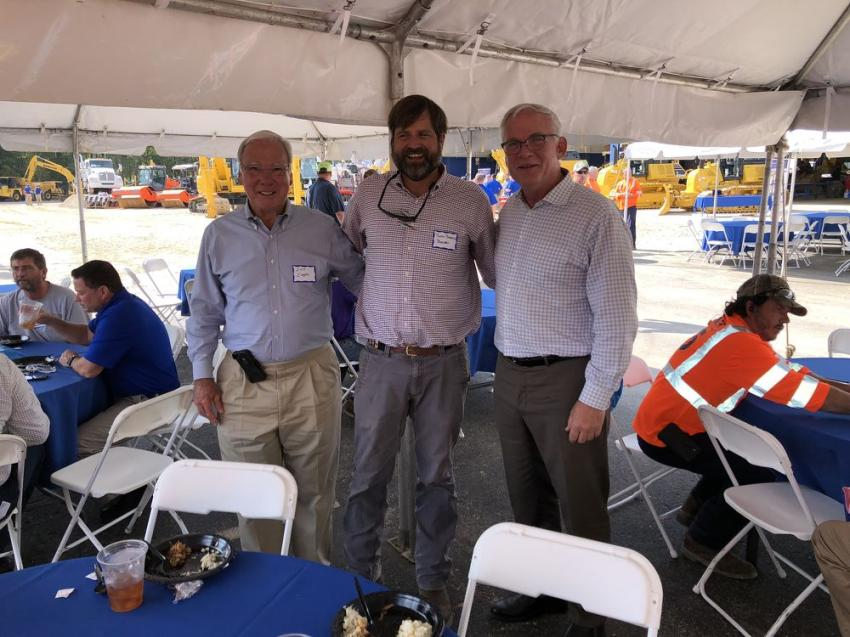 (L-R): Lee Cooper and Justin Barnhill, both of Barnhill Contracting in Rocky Mount, N.C., are welcomed to the celebration by John Coughlin, president of Linder.