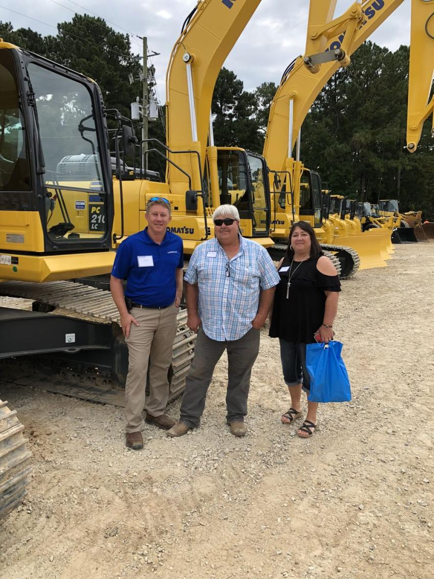 (L-R): Jay Terry of Linder goes over the Komatsu excavators with Brian and Kim Colbert, BCS Contractors, Spring Hope, N.C.