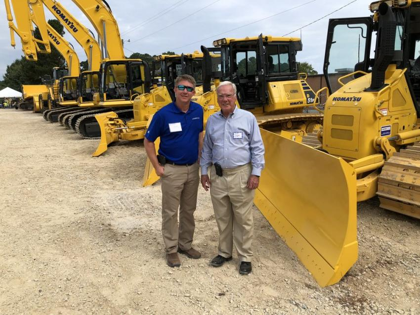 Jay Terry (L) of Linder goes over Komatsu products with Lee Cooper of Barnhill Contracting in Rocky Mount, N.C.