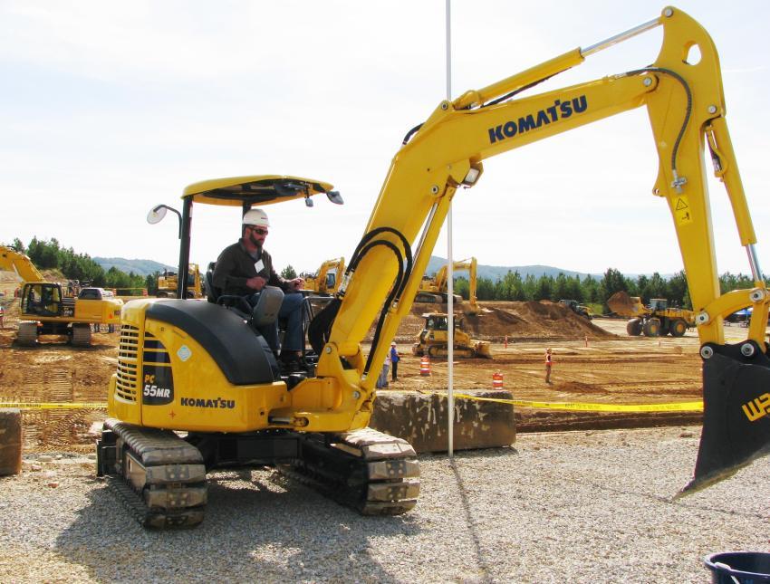 Joshua Lisowski of Stuart Lisowski Excavation, Covington, Pa., operates a Komatsu PC55MR excavator during the excavator competition.