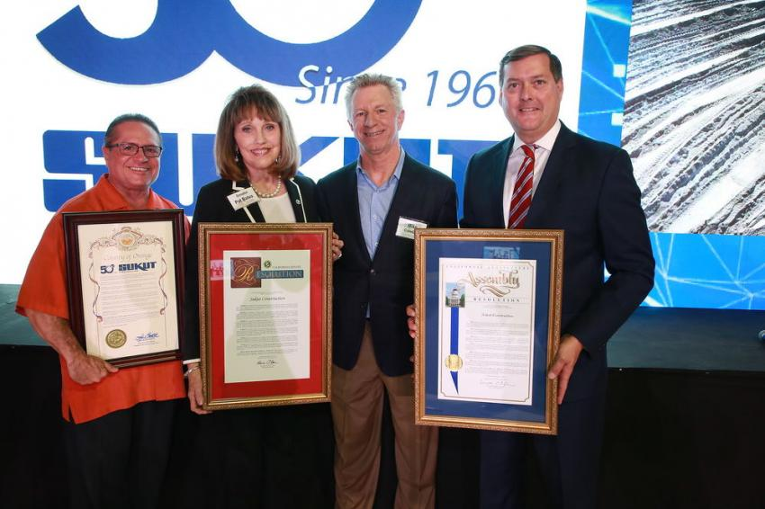 Michael Crawford (2nd from R), CEO of Sukut Construction, receives resolutions and proclamations from (L-R) Sergio Prince, Ocean County Board of Supervisors community relations advisor; Sen. Patricia Bates; and Assemblyman Bill Brough. The resolutions and proclamations congratulate Sukut on 50 years of excellence and service.