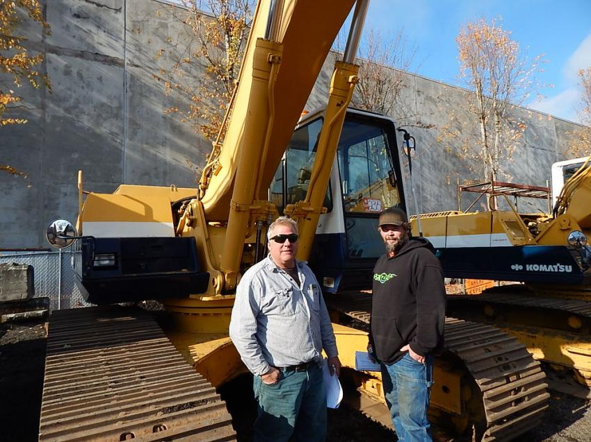 Brian Parberry (L), owner of Scrap It, Ferndale, Wash., and David Brown, Stremler Gravel Inc., operator of Lyndon, Wash., like this featured Komatsu excavator.