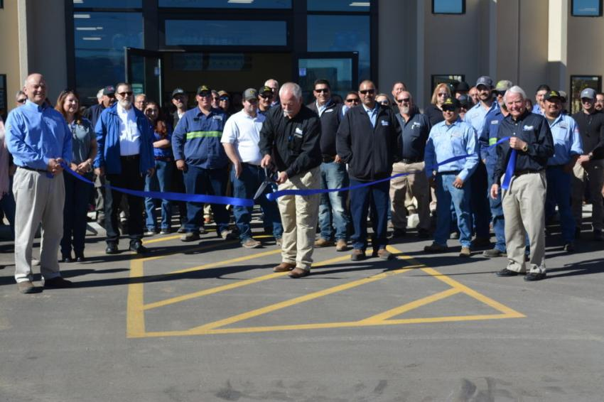 In a ribbon-cutting ceremony, John Snider (C) officially opens the newly-remodeled Albuquerque, N.M., branch of 4Rivers Equipment. Holding sides of the ribbon are John Shearer (L), 4Rivers general manager, and Keith Olson, CEO.