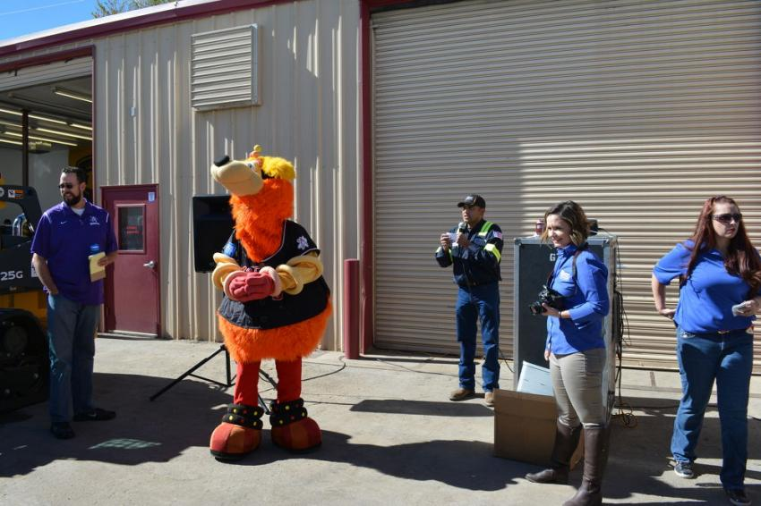 Orbit, the mascot of the Albuquerque Isotopes Triple-A baseball team, provided laughs for the crowd at 4Rivers grand re-opening of its Albuquerque branch.