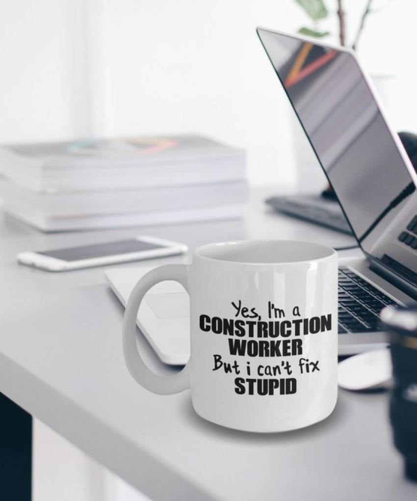 """Everyone has a person on their holiday gift list who can't resist a witty saying. If you're still looking for a present with the perfect level of snark, try this mug, which boldly states, """"Yes, I'm a construction worker but I can't fix stupid."""" It'll make those morning toolbox talks a lot more memorable.  Starting at $14.95. https://etsy.me/2B3us6f"""