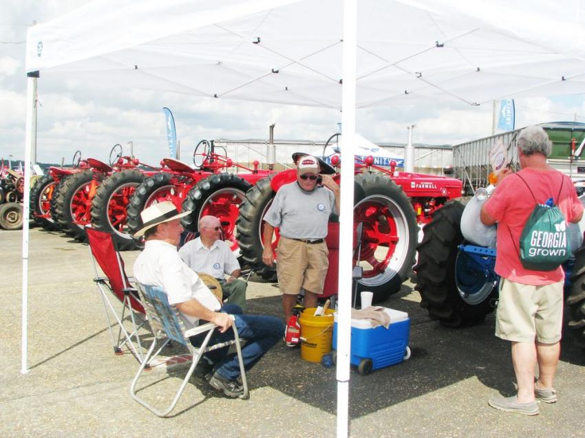 It was like a bullpen for antique tractor owners as they waited to parade their well-restored pieces through the show.