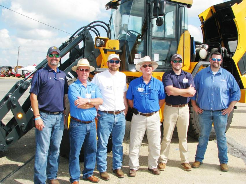 (L-R): Hyundai's Shaun Galligan; Hyundai dealer representatives David Crockett, Jeremy Register, Jerome Crosby and Brandon Hunter of Crosby Equipment; and Hyundai's Chad Parker brought out some big Hyundai iron to the Ag Expo.