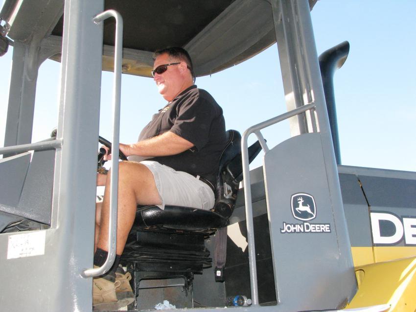Putting a Deere 544J wheel loader to the test is Jerry Dakin of Dakin Dairy Farms, Myakka City, Fla.