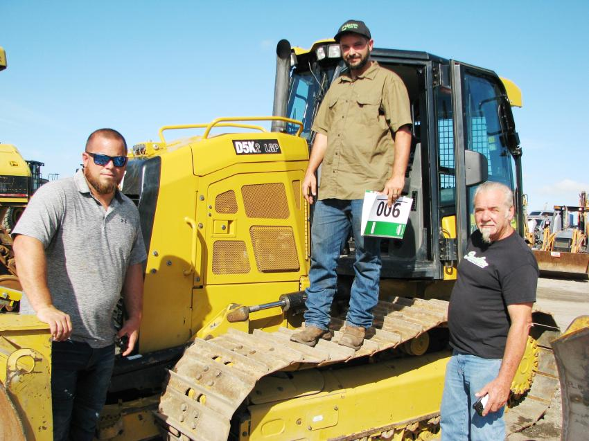 All over a Cat D5K2 LGP of interest (L-R) are Rick Hatcher, Travis Ingalsbe and Tony Richards of Southern Site Services, Daytona Beach, Fla.