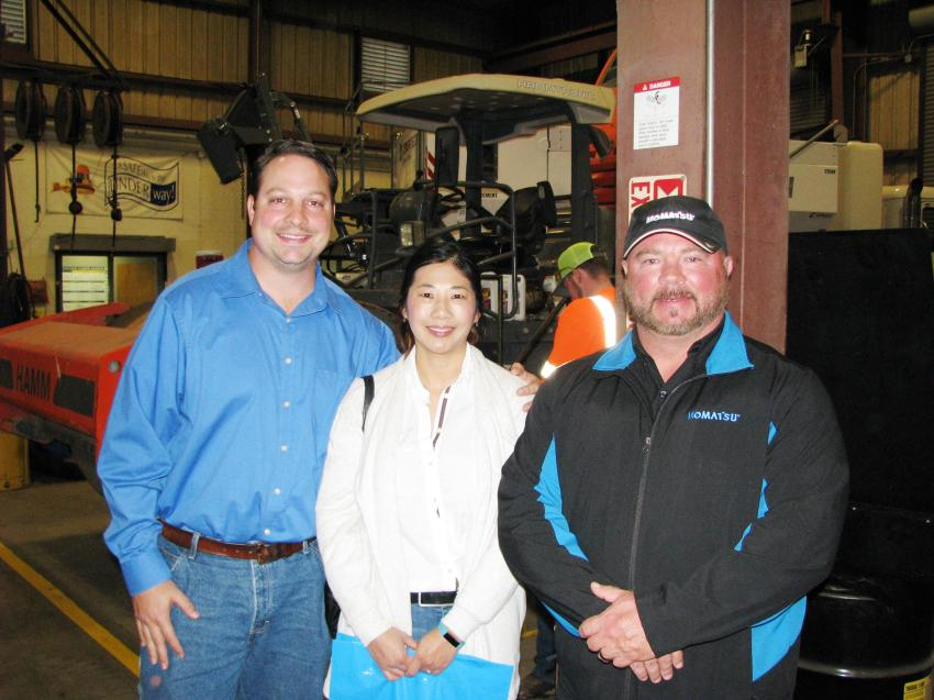 Linder's David Peacock (R) provides a tour of the Jacksonville facility to his customer friends Tim and Doris Stewart of Superior Construction, Jacksonville, Fla.