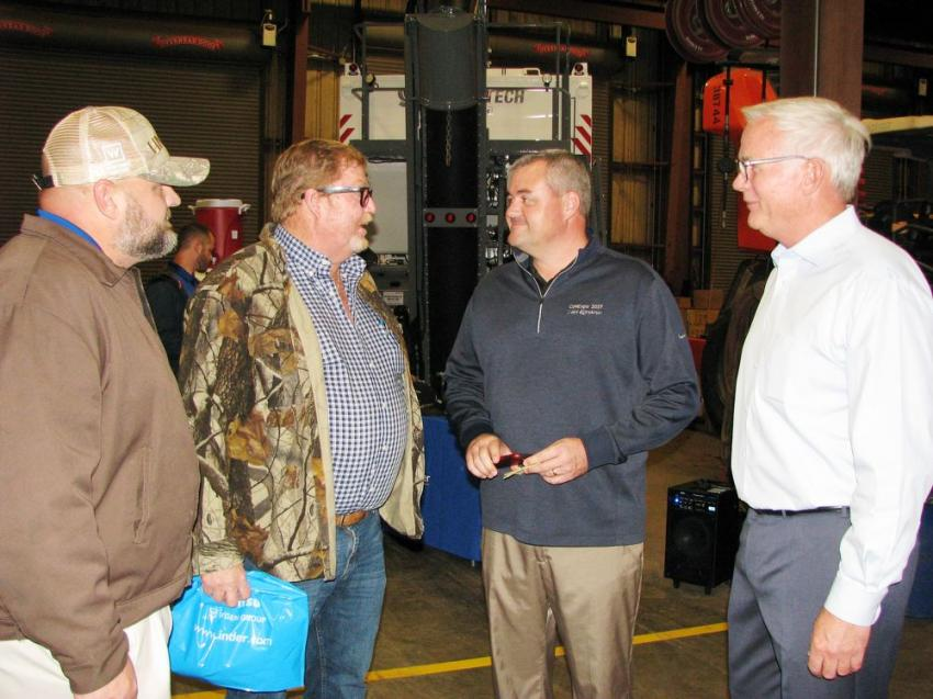 Enjoying some conversation during the Jacksonville event (L-R) are Michael Knowles, of Linder Industrial Machinery; Randy Maloy of Kudzue 3 Trucking & Paving, Kingsland, Ga.; and Chris Wilkes and John Coughlin of Linder.