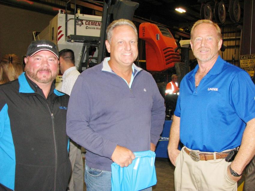 Taking a look around the shop area of the Jacksonville branch (L-R) are David Peacock, Linder Industrial Machinery; Ed Porter, Barco-Duval Engineering, Jacksonville, Fla.; and John Spitznagel, also of Linder.