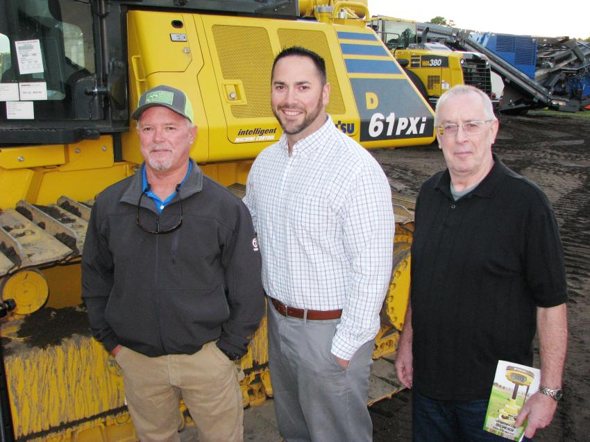 "Discussing the Komatsu Intelligent Machine Control dozers at the Jacksonville event (L-R) are Ken Bailey, Linder customer fleet advisor; and customers Brian Jones and Steve Jones of Superior Construction, Jacksonville, Fla., who stated their Komatsu Machine Control dozer is ""spot on"" for grading work."
