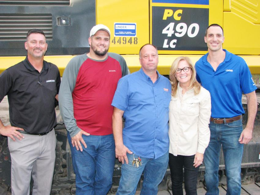 Linder Industrial Machinery Orlando staffers join their customer-friends at the event (L-R) including Brian Brenneman, Linder; Dan Chillon, John Bevers and Candice Blomeley of JMHC Inc., Orlando, Fla.; and Anthony Gaynor of Linder.