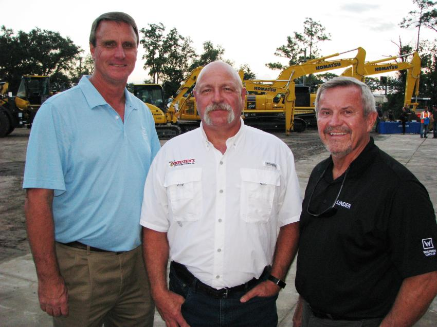 (L-R): Bo Andrew, Wirtgen Group's Kleemann crushing representative; Greg Moro, Independence Recycling of Florida, Punta Gorda, Fla.; and Robert Holland, Linder crushing and screening specialist, discuss the latest in concrete recycling products at the Orlando open house.