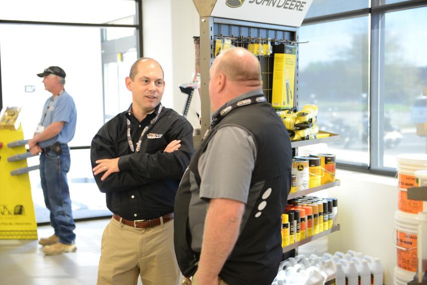 JESCO President Jon Robustelli (L) speaks to JESCO Customer Service Advisor Jed Sturbutzel at the open house. (Gellman photo)