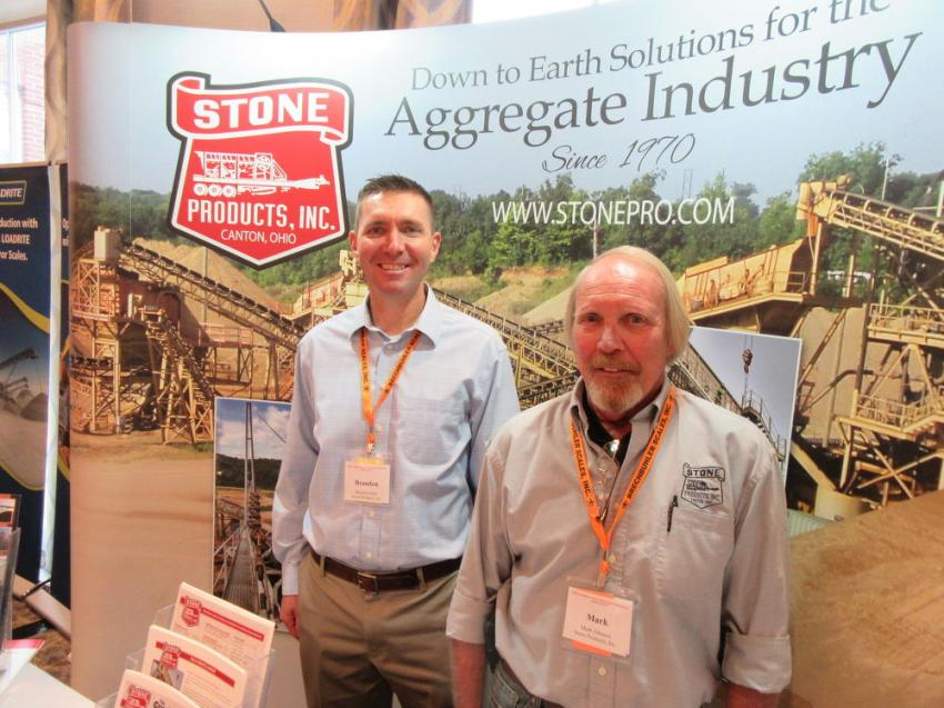 Stone Products' Brandon Mills (L) and Mark Johnson greet attendees who stopped by to visit at their tabletop display.