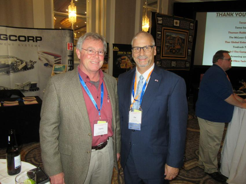Larry Fleeman (L) of Dredge Central LLC speaks with OAIMA Executive Director Patrick Jacomet at the reception.