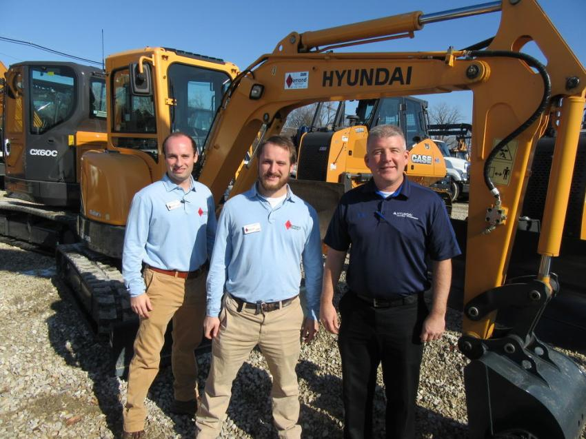 (L-R): Diamond Equipment's Travis and Chase Clement joined Hyundai Construction Equipment District Sales Manager Ed Harseim in the dealership's equipment yard.