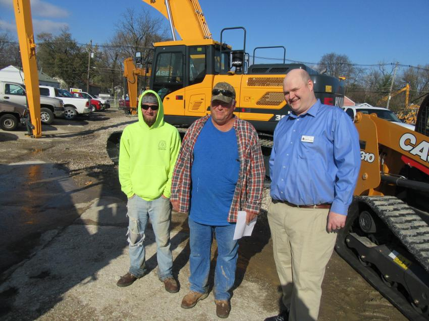 (L-R): Zachery Hurley and Gary Riecken of Riecken Construction spoke with Diamond Equipment's Tommy Gish about the equipment in the yard before heading in to join the festivities.