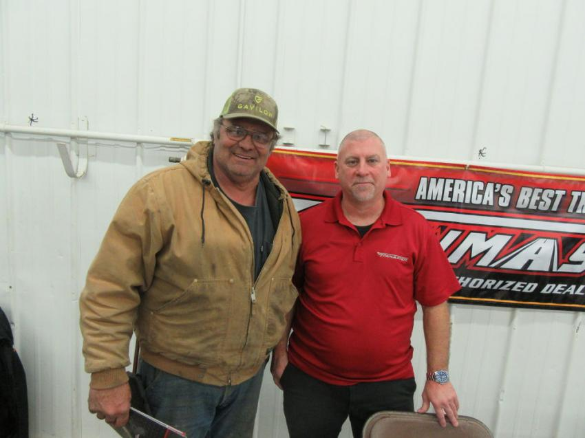 John Fisher (L) of Parrish Farms talks equipment transportation with Russ Woelke of Towmaster Trailers.