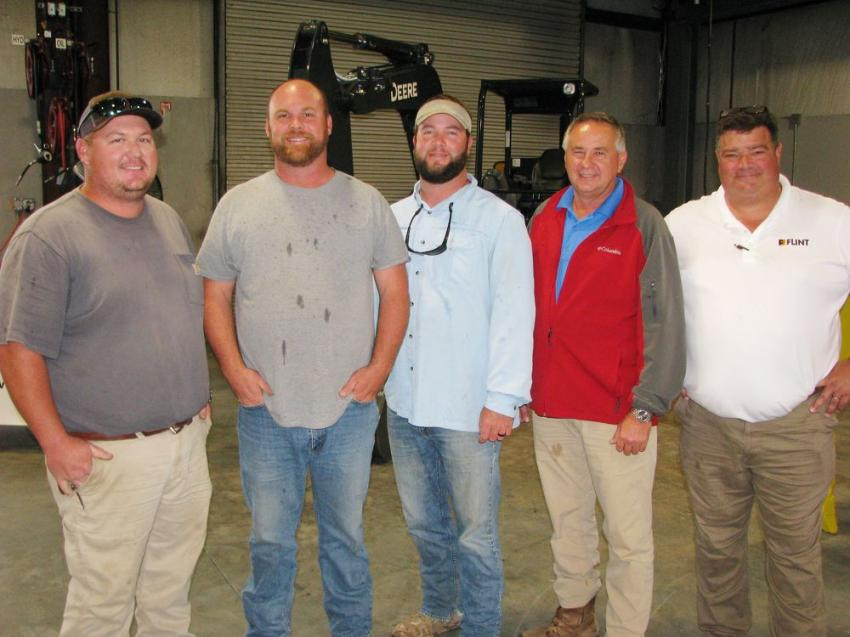 (L-R): Catching up on what's going on around town are Justin Sims, Sims Fence Company; Tommy Corbett, James Green, and Lee Waldrop of The Scruggs Company; and their local Flint salesman, Jim Rodgers.