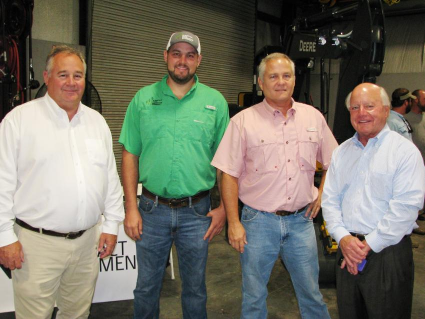 (L-R): Bill Murphree, Flint Construction & Forestry Division; Zac Mullis and Eric Harris of Superior Pine Products Co., Fargo, Ga.; and Chris Cannon talk about the forestry industry in the state of Georgia.