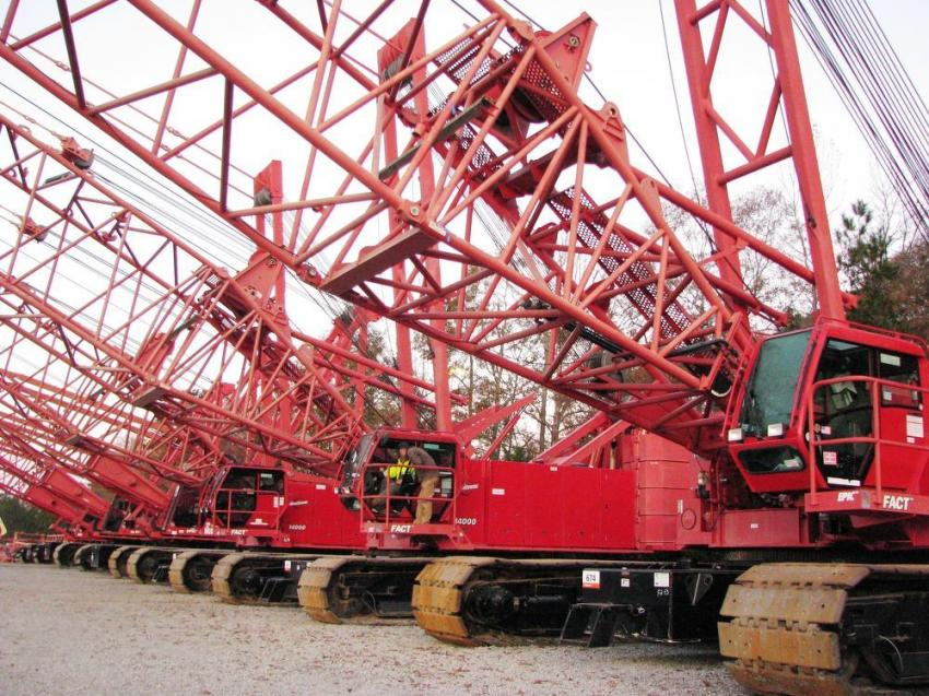 A package of three Manitowoc 2250 and three Manitowoc 14000 lattice boom cranes was a prominent sight on the auction yard at the Atlanta sale.