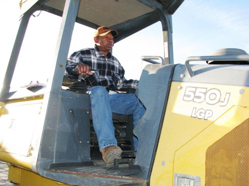 Test-operating a Deere 550J LGP dozer is Clayton Odom of TROS Logging, Monroeville, Ala.