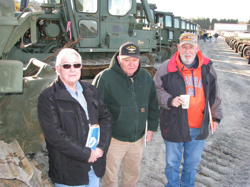 A huge package of military machines and a seemingly endless selection of miscellaneous military items brought out retired veterans (L-R) including Phillip Treadway, retired U.S. Army from Rainbow City, Ala.; Jerry Kilpatrick, Washburn Trucking, Boaz, Ala., retired U.S. Navy; and William Fielding, also retired U.S. Army.