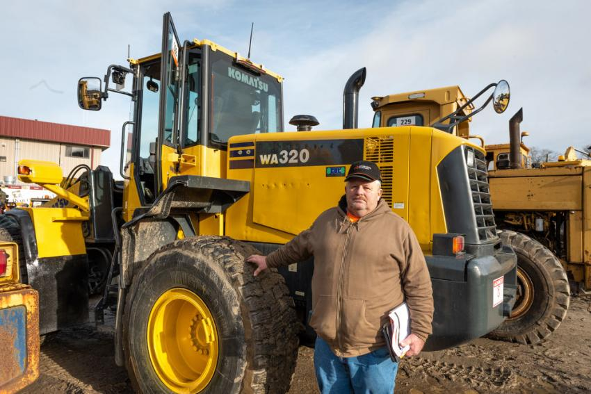 Brian Barlow of Barlow Construction in Greenfield, Mass., checks out this 2009 Komatsu WA320-6 wheel loader.