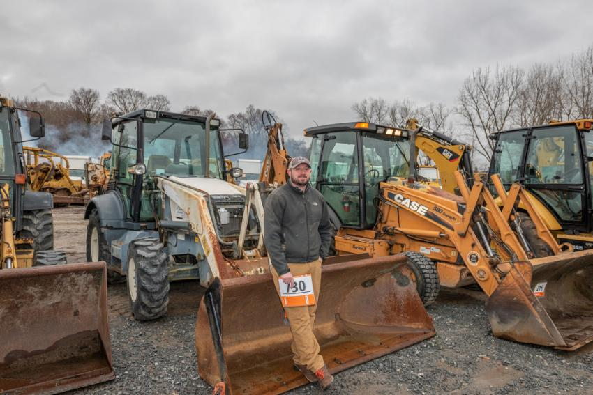 Jeff Morton of Lisbon, Conn., stands in front of the many choices of backhoes.