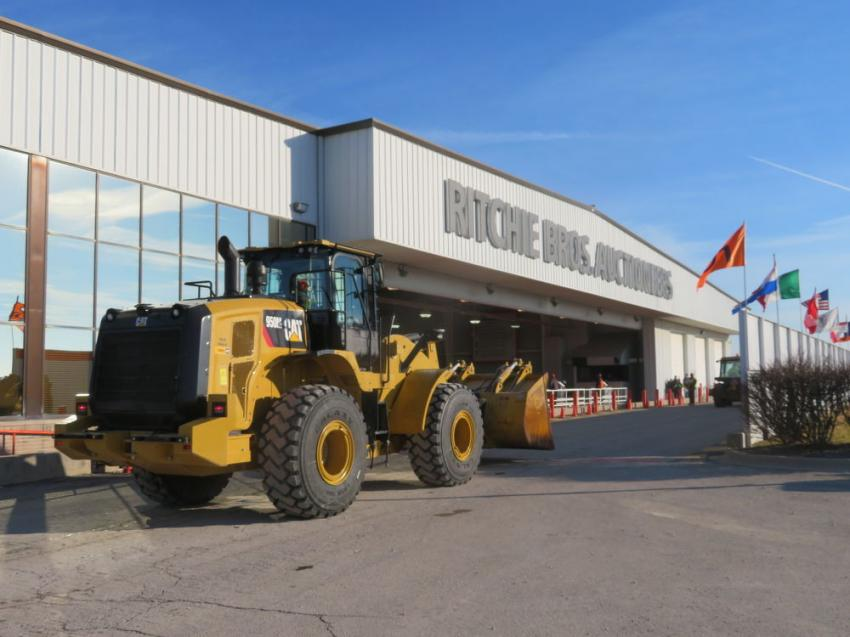 A Cat wheel loader goes over the auction ramp.