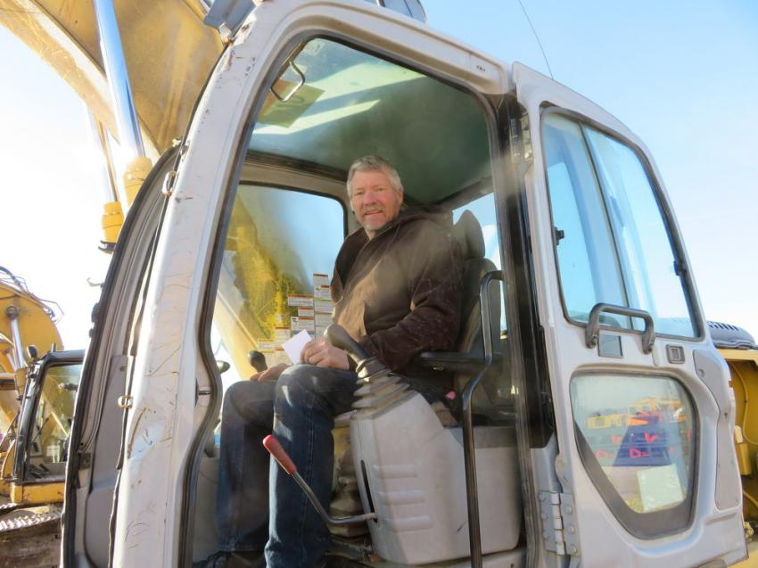 Rod Fry of Fry Excavating runs a Kobelco SK160 excavator at the Dec. 18 auction.