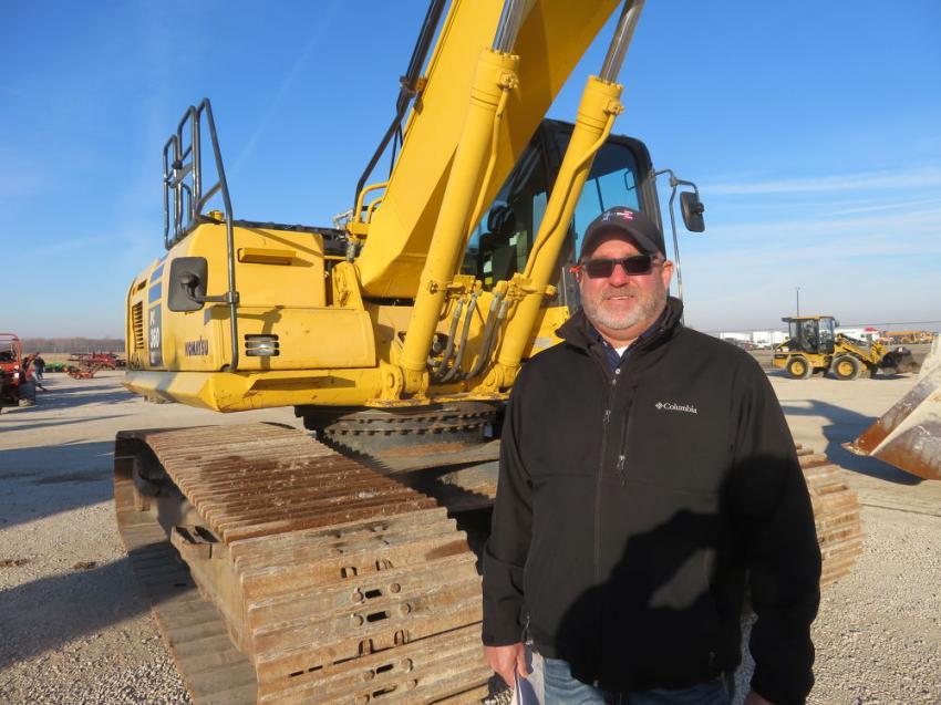 Jay Germann, general manager, used equipment, Roland Machinery Co., inspects a Komatsu PC360 excavator.