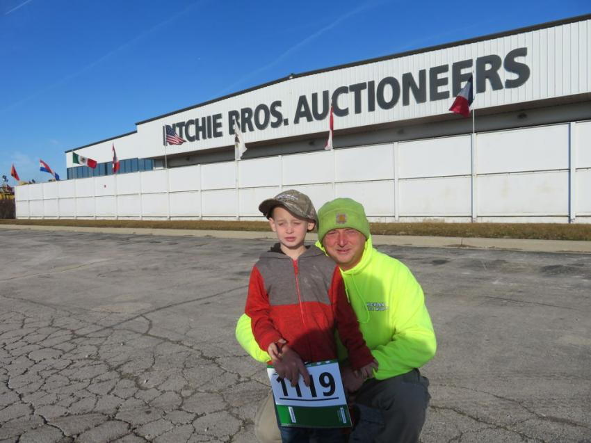 Briley Lantzer of Michiana Tree Works brought his son, Braxton, to the auction to see all the big iron.