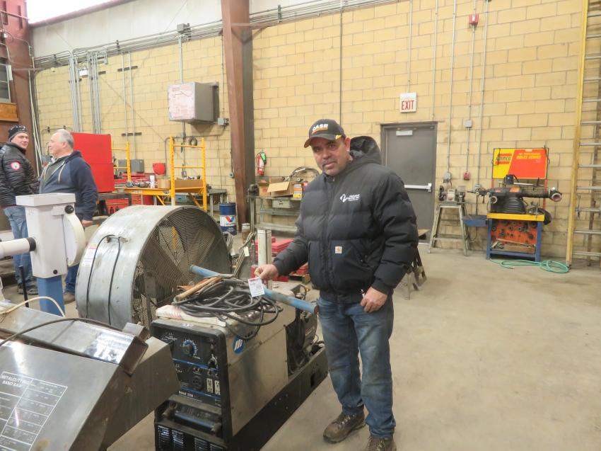 Juan Guardarranna of Premium Paving Inc. has a look at some of the shop equipment at the auction.