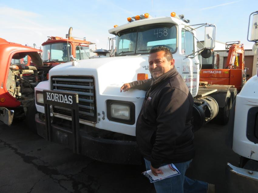 John Avelar, owner of J. Ave Development, looks over the Mack trucks.