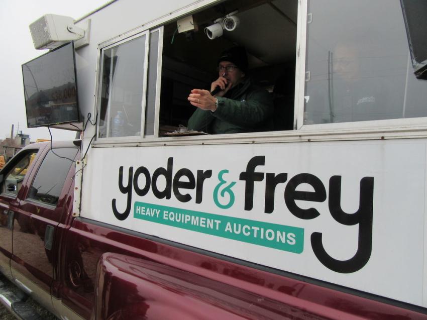 Yoder & Frey auctioneer Matt Hostetter calls out another winning bid.