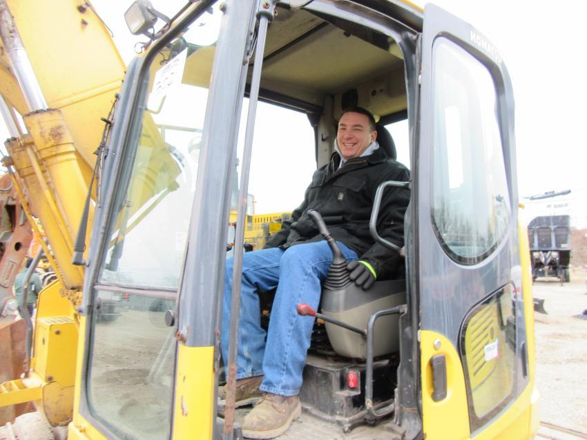 Joe Kowosky of Mid Ohio Labor considers a bid on a Komatsu PC138US excavator.
