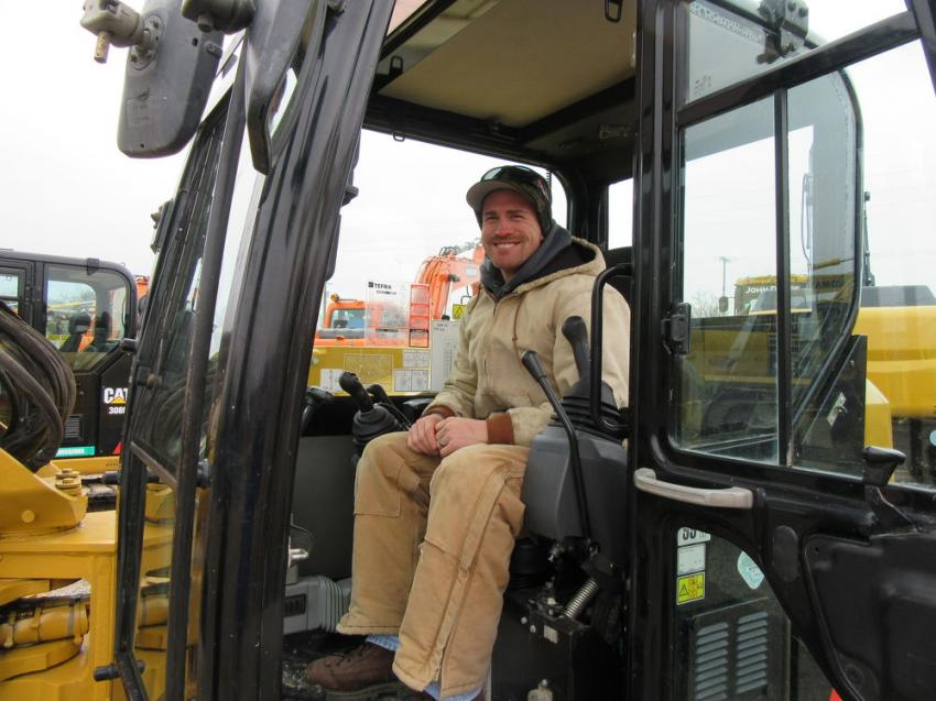 Caleb Tier of BJ Excavating found shelter from the cold in a Cat 308E excavator, one of four of this model up for bid.