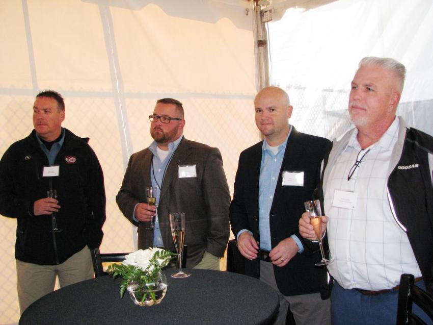 (L-R): Britt Hefner, ACT Equipment, Charlotte, N.C.; Ben Chris, Doosan Infracore North America, Southeast district manager; and Whitney Page and Scott Hasier of Synergy Equipment, Tampa, Fla., prepare to raise a glass to toast the grand opening.