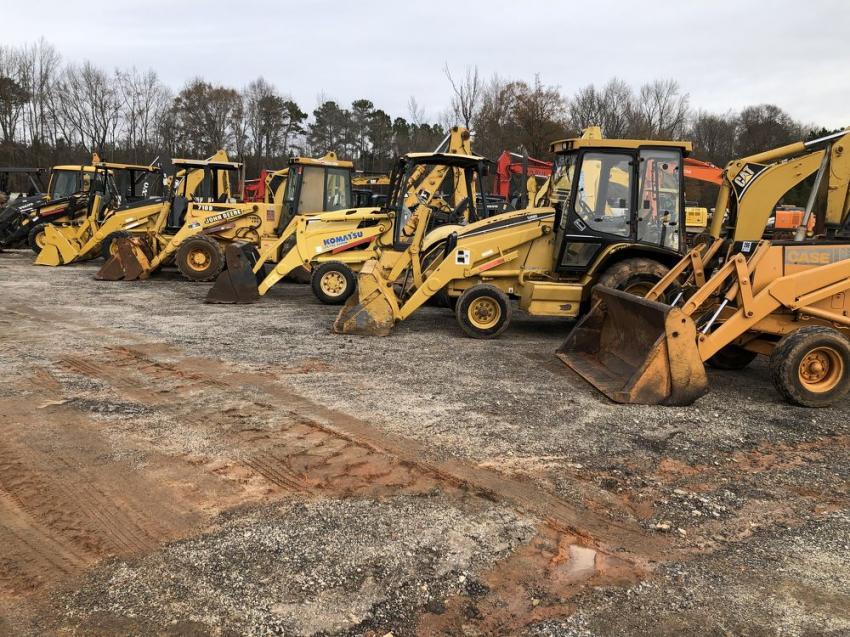 A wide assortment of backhoes was available.