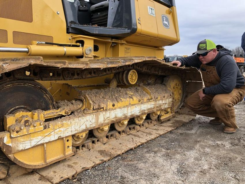 Jeremy Peterson, Superior Grading, Greenville, S.C., looked over the John Deere undercarriage for excessive wear.