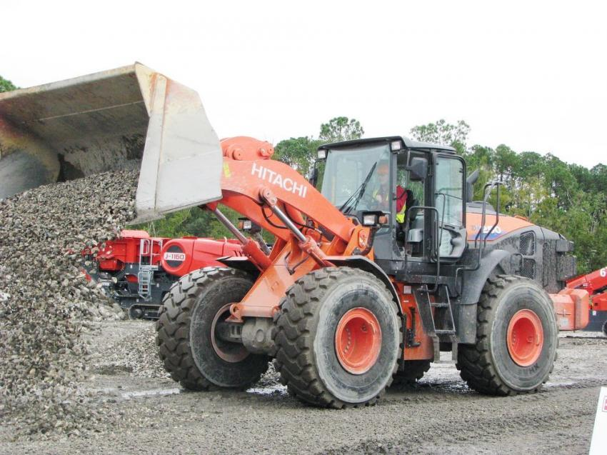 Heavy rainfall made things a bit messy at the demo site. The Great Southern Equipment Company (GSE), the local Florida Hitachi dealer, was able to remedy the problem by supplying a Hitachi ZW250 to spread rock throughout the site.