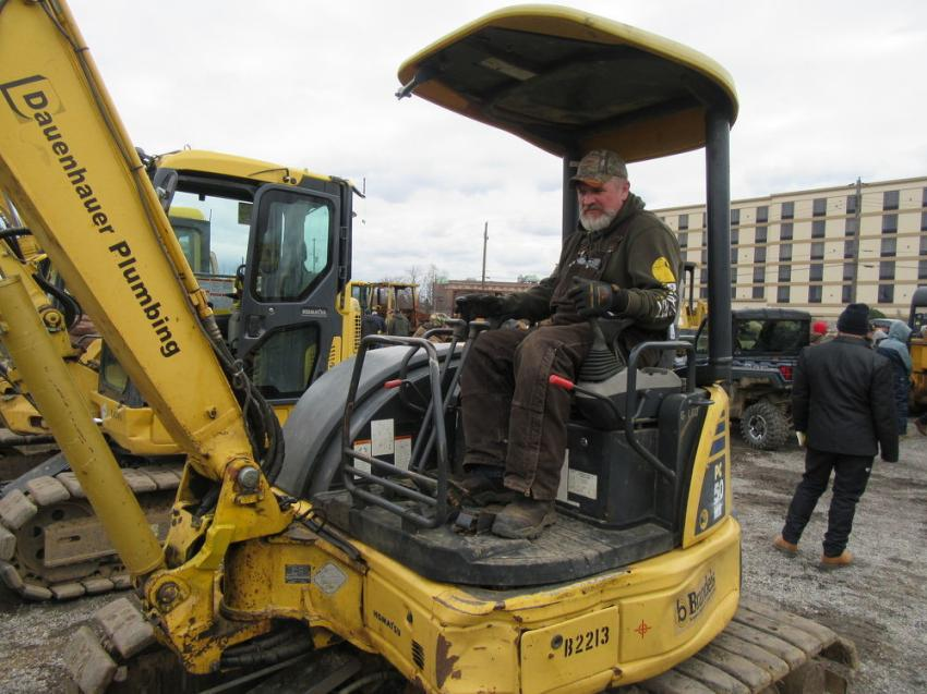 Pat Carby of Midland Powder tries out a Komatsu PC50 mini-excavator.